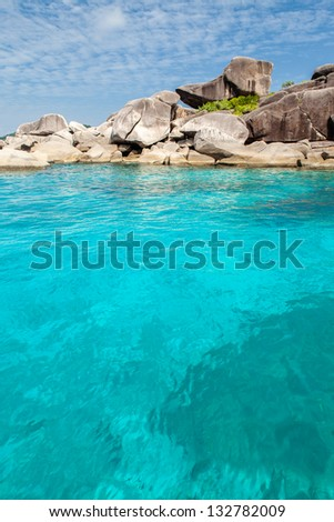 Crystal clear water at Similian Islands during snorkeling trip. - stock photo