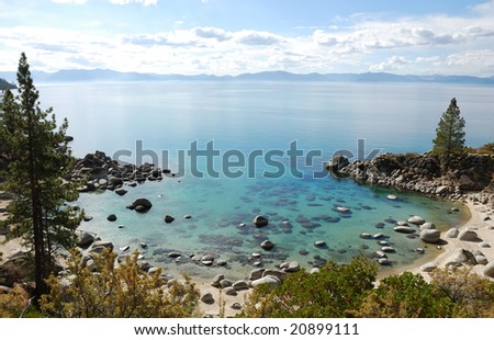 Crystal Clear Water Bay on Lake Tahoe with Sunny Skies - stock photo