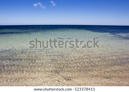 Crystal clear water of the Indian Ocean at pristine Hutt's Beach near Bunbury Western Australia on a hot summer afternoon is cool and inviting.