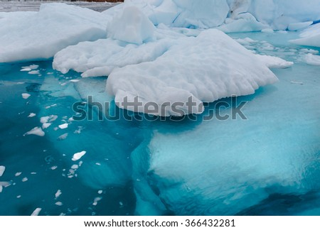 Crystal Clear water shows the huge percentage of icebergs reside under water - stock photo