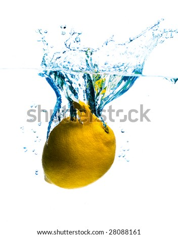 crystal clear water splashing from a fruit