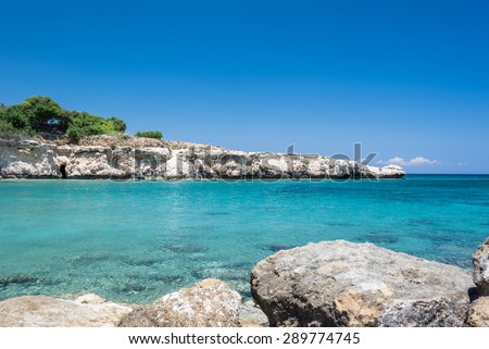 Crystal clear waters and sandstone rocks of the Mediterranean Sea, Cyprus - stock photo