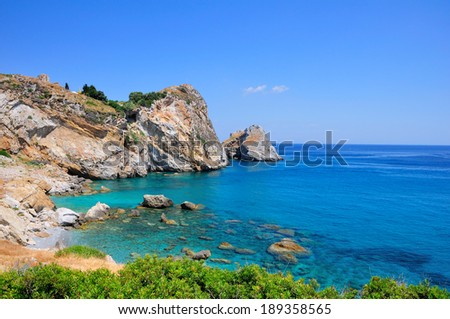 Crystal clear waters at Kastro beach, Skiathos, Greece - stock photo