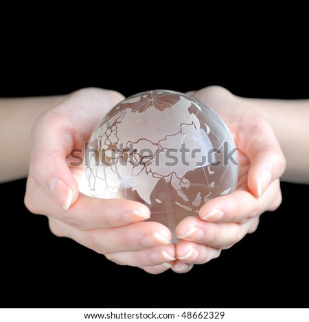 Crystal Earth In Hands isolated on black ground