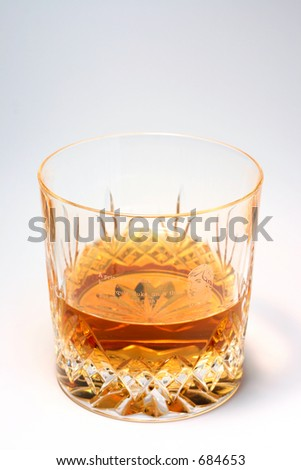Crystal glass of whisky - stock photo