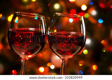 Crystal glasses of wine on the background of Christmas lights - stock photo