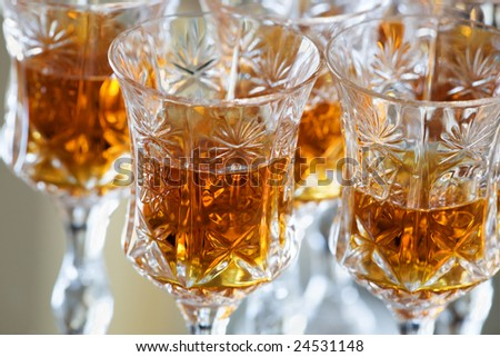 Crystal glasses with strong liquor - stock photo