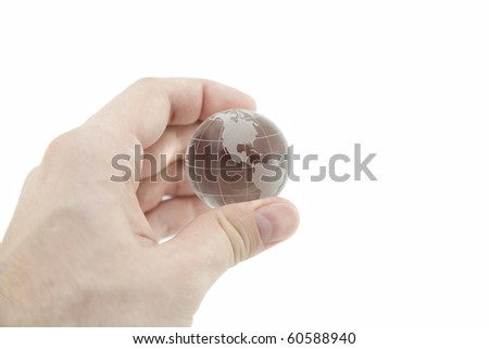 Crystal globe in hand with clipping path - stock photo