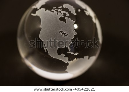 Crystal globe on black background