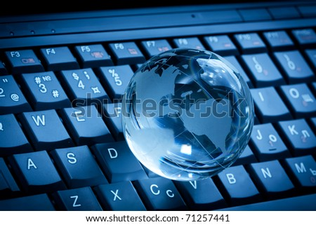 Crystal globe on laptop keyboard