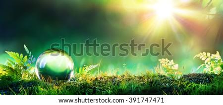 Crystal Green Globe On Moss - Environmental Concept - stock photo