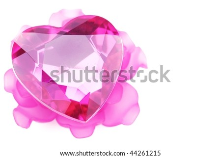 crystal heart with pink flower ornament isolated on the white background.