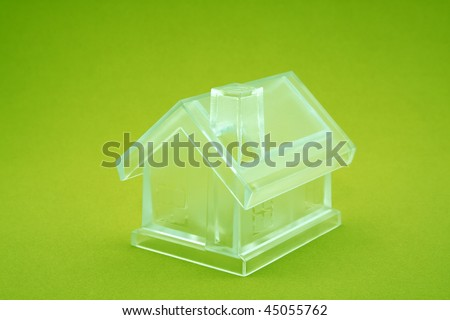 Crystal house on green background - stock photo