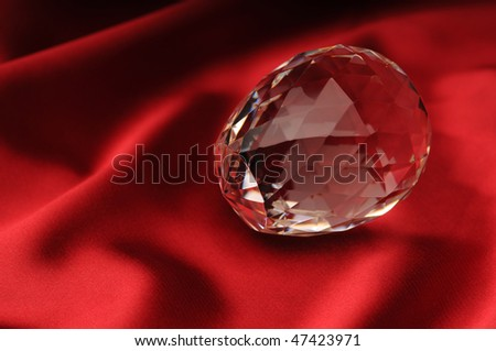 crystal lies on a red background
