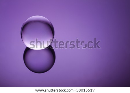 Crystal orb on a purple gradient - stock photo