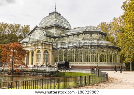 Crystal Palace (Palacio de cristal) in the Retiro Park in Madrid. Spain. It was built in 1887 to exhibit flora and fauna from the Philippines. The architect was Ricardo Velazquez Bosco. - stock photo