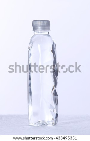 Crystal Polygon plastic bottle of water isolated on a white background - stock photo