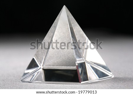 Crystal Pyramid on silver and black background