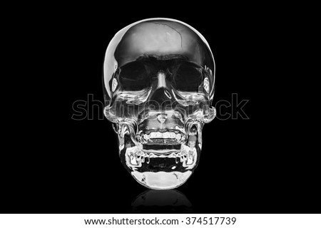 Crystal skull ancient South American artifact on black - stock photo