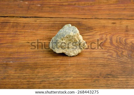 crystal sulfur on the wooden table - stock photo