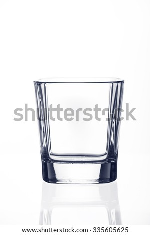 Crystal whiskey glass or cup isolated on white background - stock photo