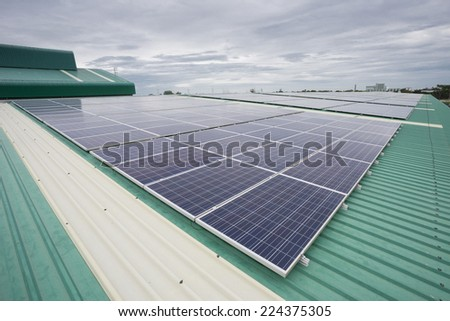 Crystalline Silicon Photovoltaics on Factory roof - stock photo