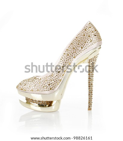 crystals encrusted gold shoe isolated on white - stock photo