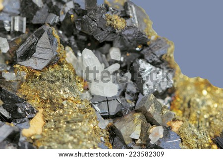 Crystals of pyrite on galena on a  blue background - stock photo