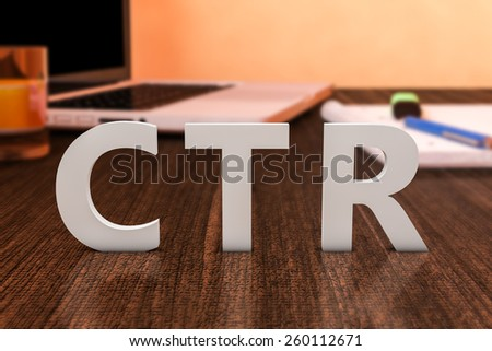 CTR - Click Through Rate - letters on wooden desk with laptop computer and a notebook. 3d render illustration. - stock photo