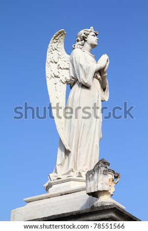 Cuba - angel statue in the cemetery of Cienfuegos.