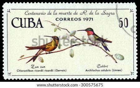 CUBA - CIRCA 1971: A stamp printed by Cuba, shows birds Cuban emerald and Ruby-throated hummingbird, Chlorostilbon ricordii and Archilochus colubris, , circa 1971 - stock photo