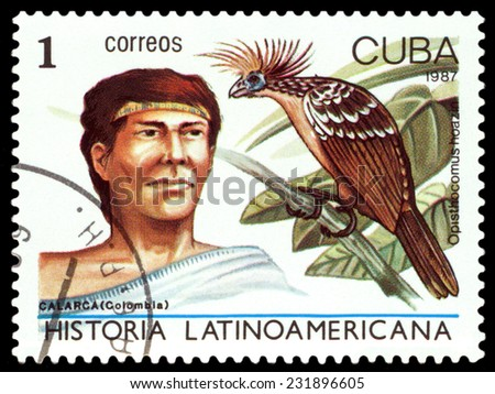 CUBA - CIRCA 1987: A stamp printed by Cuba, shows  Calarca Indian of Colombia and bird Opisthocomus hoazin, Latin American History, series , circa 1987  - stock photo