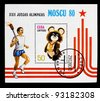 CUBA - CIRCA 1980: A stamp printed in CUBA, devoted to Olympic Games in Moscow (1980), person carries torch with fire, bear symbol, circa 1980 - stock photo