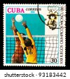 CUBA - CIRCA 1980: A stamp printed in CUBA, devoted to Olympic Games in Moscow (1980), woman playing volleyball, bear symbol, circa 1980 - stock photo