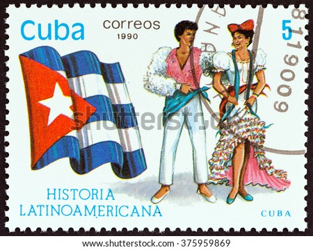 """CUBA - CIRCA 1990: A stamp printed in Cuba from the """"Latin American History 5th series"""" issue shows Flag and Traditional Costumes Cuba, circa 1990. - stock photo"""