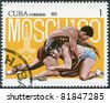 CUBA - CIRCA 1979: A stamp printed in Cuba, is dedicated to the Olympic Games in Moscow, shows the Greco-Roman wrestling, circa 1979 - stock photo