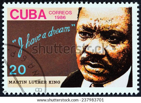 CUBA - CIRCA 1986: A stamp printed in Cuba issued for the 18th death anniversary of Martin Luther King shows human rights campaigner Martin Luther King, circa 1986. - stock photo