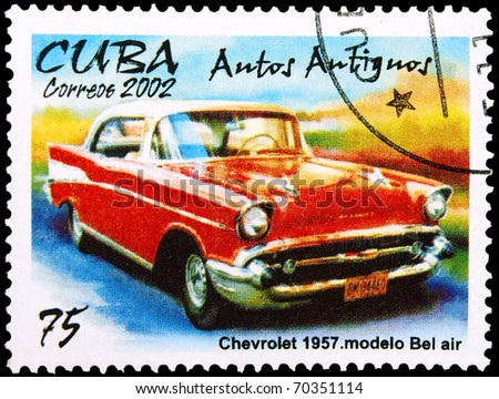 CUBA - CIRCA 2002: A stamp printed in Cuba showing vintage car, circa 2002 - stock photo