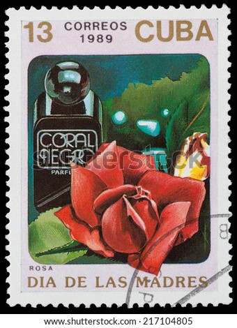 CUBA - CIRCA 1989: A stamp printed in Cuba shows a Bottle of rose perfume, circa 1989 - stock photo