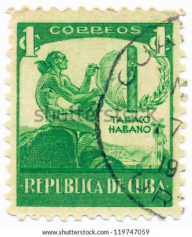 CUBA - CIRCA 1937: A stamp printed in Cuba shows Ciboney Indian and Cigar, circa 1937 - stock photo
