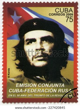 CUBA -CIRCA 2009: A stamp printed in Cuba shows commander Ernesto Guevara de la Serna (Che Guevara) and the Republic of Cuba national flag, 50th anniversary of the Cuban revolution Victory, circa 2009 - stock photo