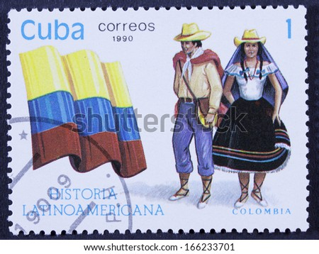 "CUBA - CIRCA 1990: A stamp printed in Cuba, shows Flag and a couple dressed in national costumes from Colombia, with inscription and name of series ""Latin American history"", circa 1990.  - stock photo"