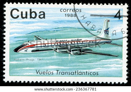 "CUBA - CIRCA 1988: A Stamp printed in CUBA shows image of airplane, with inscription ""Habana - Prague, 1961"", from the series ""Cubana Airlines Transatlantic Flights"", circa 1988 - stock photo"