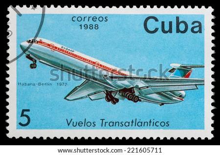 CUBA - CIRCA 1988: A Stamp printed in CUBA shows image of the airplane in transatlantic flight, Havana - Berlin in 1972, circa 1988 - stock photo