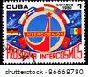 CUBA - CIRCA 1980:  A stamp printed in Cuba shows logo and flags of the defunct Communist Block Intercosmos Space Program, circa 1980. - stock photo