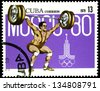 "CUBA - CIRCA 1979: A stamp printed in CUBA shows Olympic emblem and Weightlifting, with the inscription ""Moscow, 1980"", from the series ""XXII Olympic Games in Moscow, 1980"", circa 1979 - stock photo"