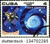 "CUBA - CIRCA 1980: A stamp printed in Cuba shows Satellite and globe (Physics), with inscription and name of series ""Intercosmos Program"", circa 1980 - stock photo"