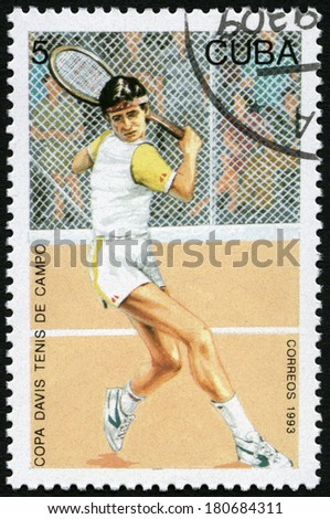 CUBA - CIRCA 1993: A stamp printed in Cuba shows tennis player in action, Davis Cup Tennis Competition, circa 1993 - stock photo