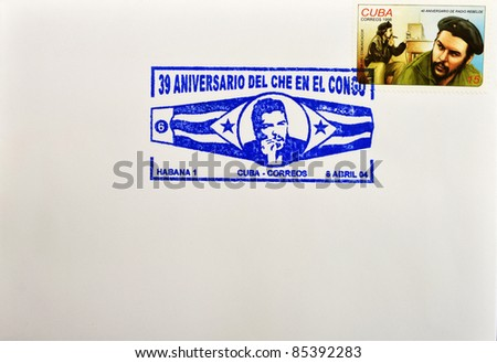 CUBA - CIRCA 1998: A stamp printed in Cuba shows the image of Che Guevara smoking and rebel radio, circa 1998 - stock photo