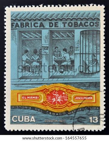 CUBA - CIRCA 1970: A stamp printed in Cuba shows tobacco factory, circa 1970  - stock photo